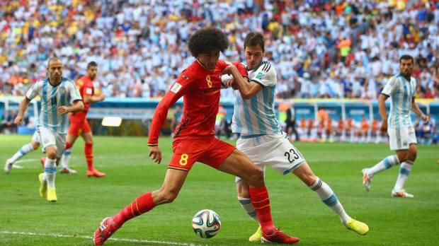 2014 Fifa World Cup - Marouane Fellaini of Belgium battles with Argentina's Jose Maria Basanta