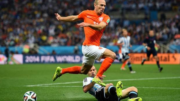 2014 FIFA World Cup - Netherlands forward Arjen Robben is challenged by Javier Mascherano of Argentina.