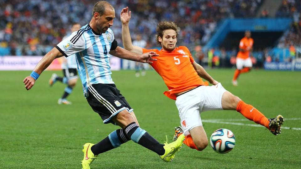 2014 FIFA World Cup - Pablo Zabaleta of Argentina is challenged by Netherlands defender Daley Blind.