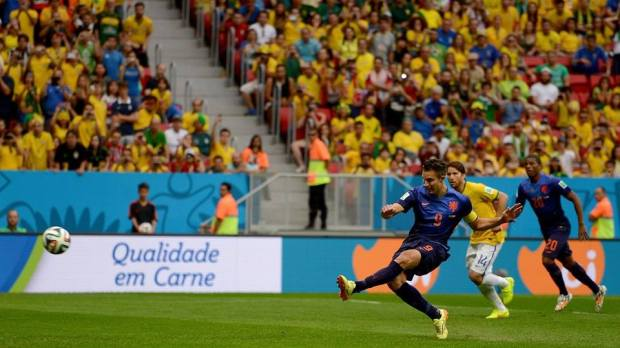2014 FIFA World Cup - Robin van Persie of the Netherlands scores his team's first goal from the penalty spot