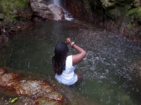 Poetess Denise Fyffe enjoying the Waterfalls at Rafjam Bed and Breakfast in Jamaica. Courtesy of Poetess Denise Fyffe