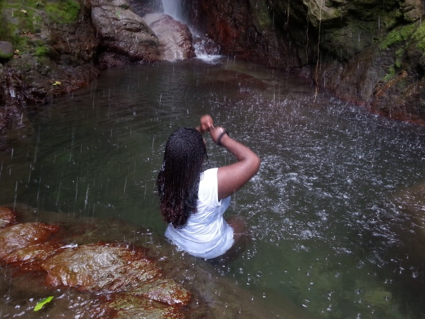 Poetess Denise Fyffe enjoying the Waterfalls at Rafjam Bed and Breakfast in Jamaica. Courtesy of Poetess Denise Fyffe