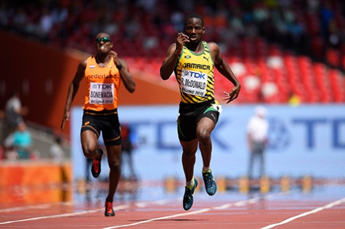 "Jamaica's Rusheen McDonald competes in the heats of the men's 400 metres athletics event at the 2015 IAAF World Championships at the ""Bird's Nest"" National Stadium in Beijing on August 23, 2015. AFP PHOTO / OLIVIER MORIN"