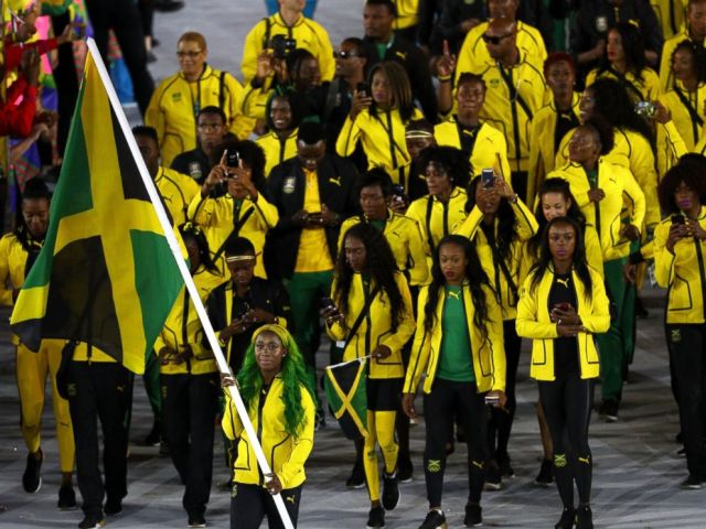 PHOTO: Flag bearer Shelly-Ann Fraser-Pryce of Jamaica leads her Olympic Team during the opening ceremony of the Rio 2016 Olympic Games at Maracana Stadium, Aug. 5, 2016 in Rio de Janeiro, Brazil.